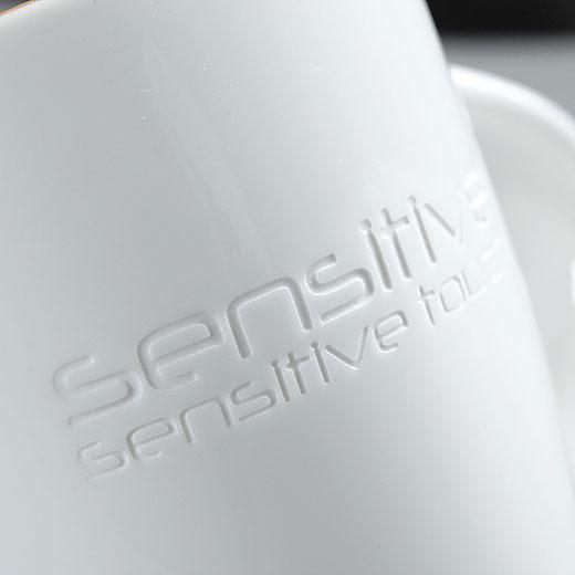 Graviravimas smėliu ant reklaminio puodelio