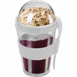 Jogurto puodelis su šaukštu